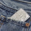 Lighter in the pocket jeans — Stock Photo