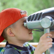 Boy is watching in the viewing glasses - Stock Photo
