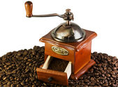 Coffee grinders to coffee beans — Stock Photo
