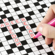 Royalty-Free Stock Photo: Solving crossword