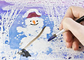 Hand draws a snowman — Stock Photo