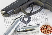 Air pistol and spare parts for weapons — Stock Photo