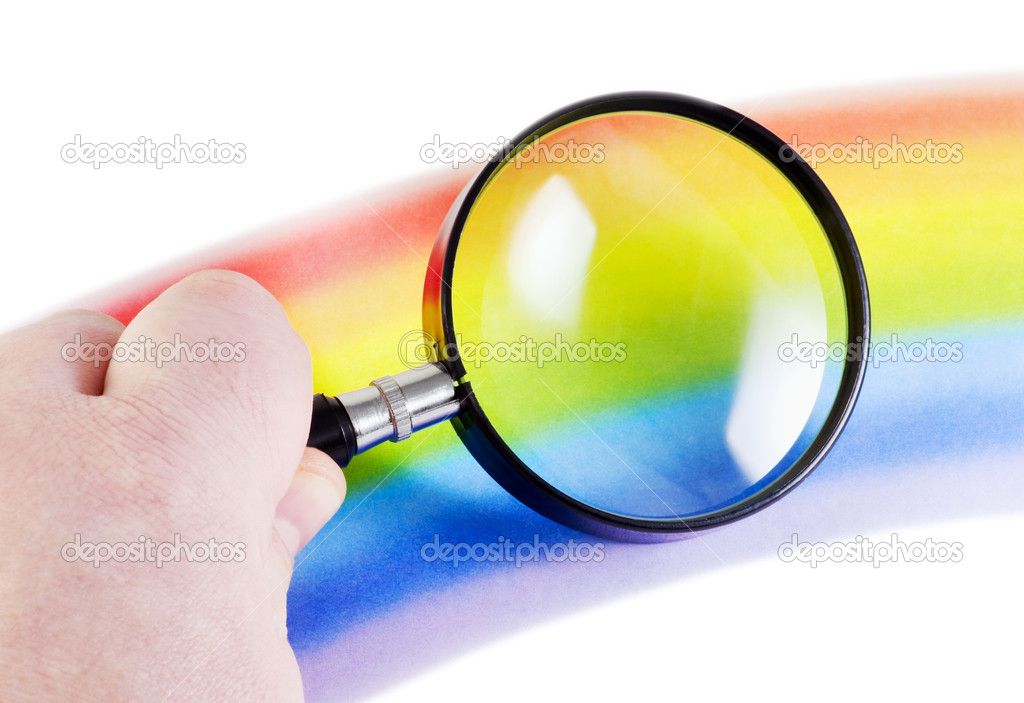 Hand with a magnifying glass is considering rainbow isolated on a white background — Stock Photo #1612852