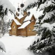 Wooden church on a snowy meadow — Stock Photo