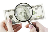 One hundred dollars under magnifier — Stock Photo