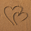 Stock Photo: Hearts drawn on sand