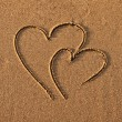 Hearts drawn on sand — Stock Photo #1303579
