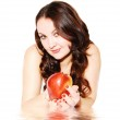 The beautiful young woman with an apple — Stock Photo