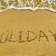 Inscription Holidays on a sand — Stock Photo