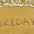 Stock Photo: Inscription Holidays on sand