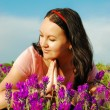 Stock Photo: The beautiful young woman in the field o