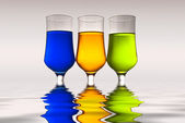 Glasses with multi-coloured drinks and r — Stock Photo