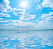 Shining sun among the blue sky — Stock Photo