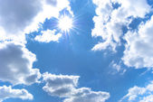 Shining sun among the blue sky and white — Foto Stock