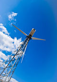 Wind power station - wind turbine agains — Stock Photo
