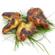 Barbecue from chicken hips decorated wit — Stock Photo #1314317