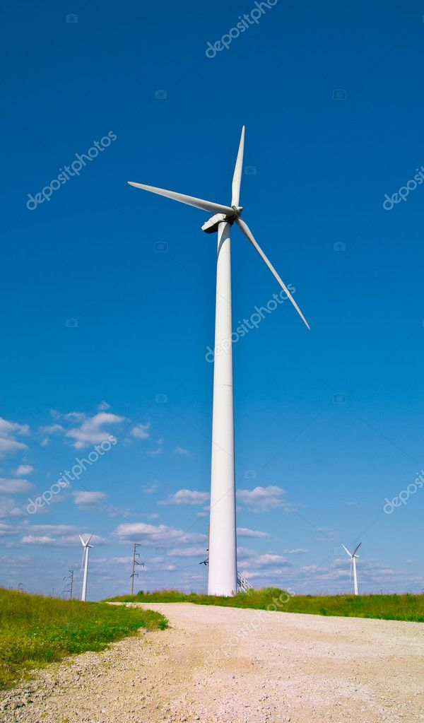 Wind power station - wind turbine against the blue sky — Stock Photo #1311577