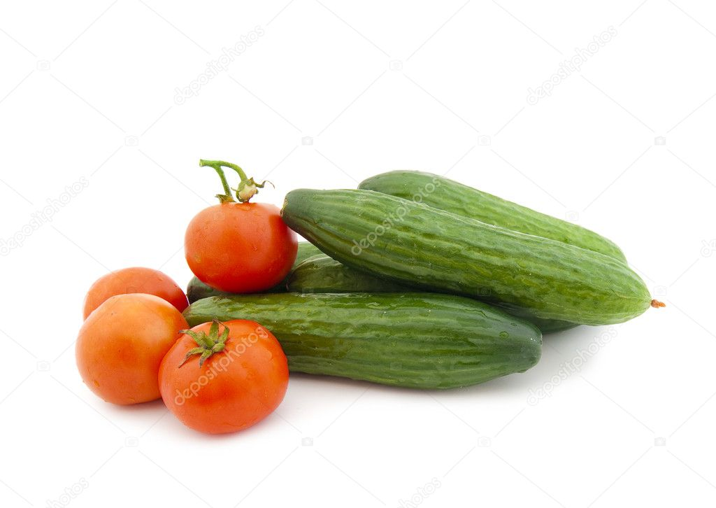 Ripe cucumbers and tomatoes on a white background — Stock Photo #1314169