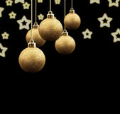 Christmas balls on a black background — Stock Photo