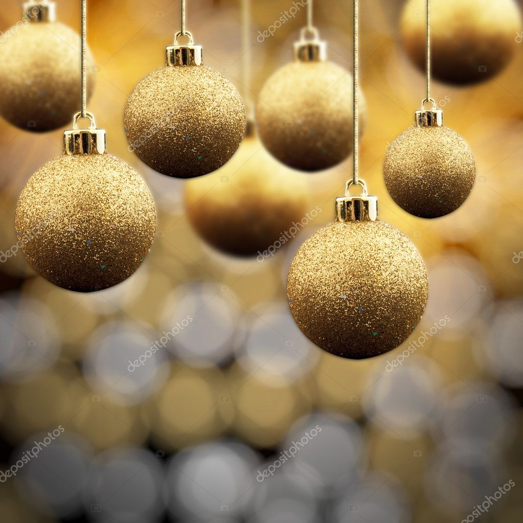 Gold Christmas balls on a multi coloured sparkling background  Foto de Stock   #1935979