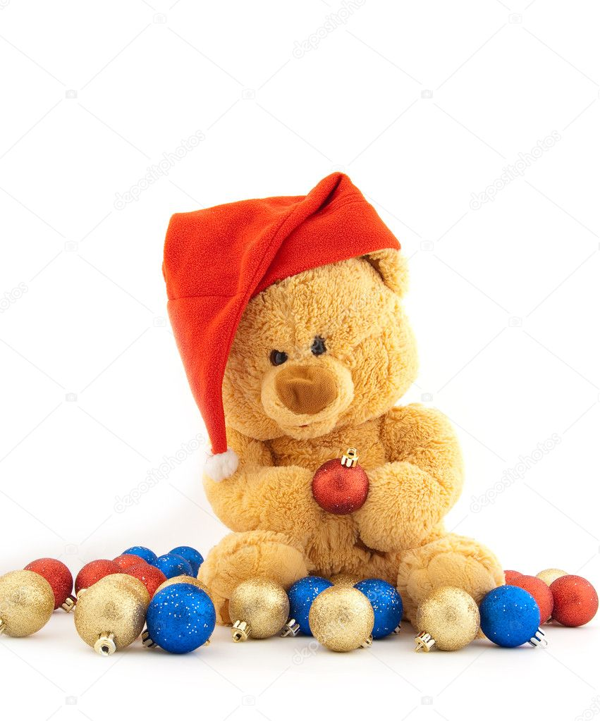 Toy bear in a Christmas cap and with Christmas-tree decorations — Stock Photo #1936731