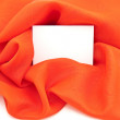 The clean white card against red silk — Stock Photo