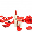 Red lipstick and petals of roses — Stock Photo