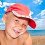 Portrait of the nice child on seacoast — Stock Photo