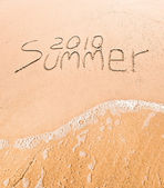 Inscription on sand Summer 2010 — Stock fotografie