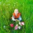 The boy with a bouquet of tulips — Stock Photo