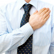 Stock Photo: BusinessmLawyer with hand on heart