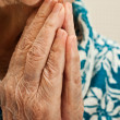 Hands in prayer, an old woman praying — Stock Photo