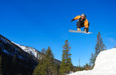 Snowboarder jumping high — Stock Photo