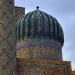 The dome and part of minaret - Stock Photo