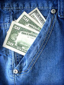 Dollars in pocket of jeans — Stock Photo