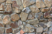 Solid stone wall — Stock Photo