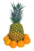 Pineapple with tangerine — Stock Photo