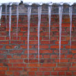 Icicles on the roof of house — Stock Photo #1573272