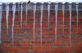 Icicles on the roof of house — Stock Photo