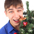 Teenager with christmas tree — Stock Photo