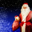 Santa with lamp — Stock Photo