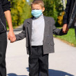 Stock Photo: Kid in flu mask
