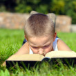 Child reads book — Stok fotoğraf