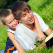 Stock Photo: Teenager and kid with book