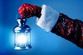 Santa holding a lamp — Stock Photo