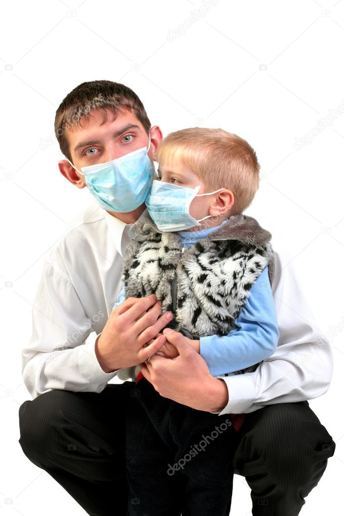 Young man and kid in the flu mask — Stock Photo #1325902