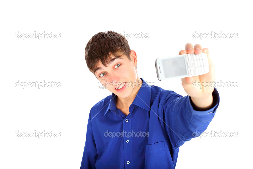 A young teenager gets ready to take a photograph — Stock Photo #1326031