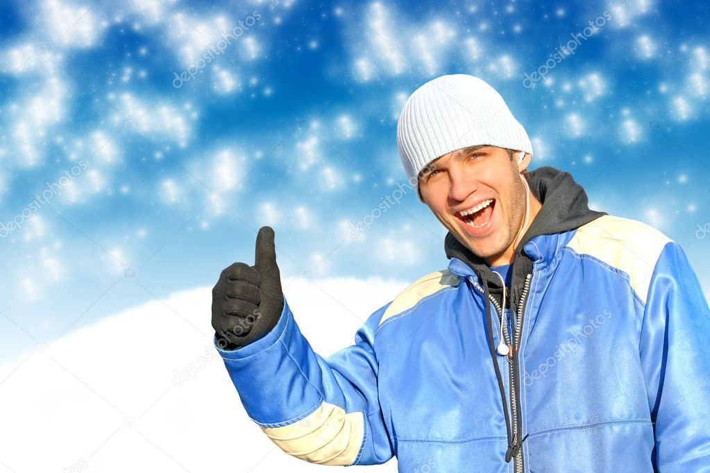 Happy man with thumb up on the witner background — Stock Photo #1326502