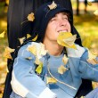 Stock Photo: Teenager in autumn park