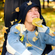 Teenager in autumn park — Stock Photo